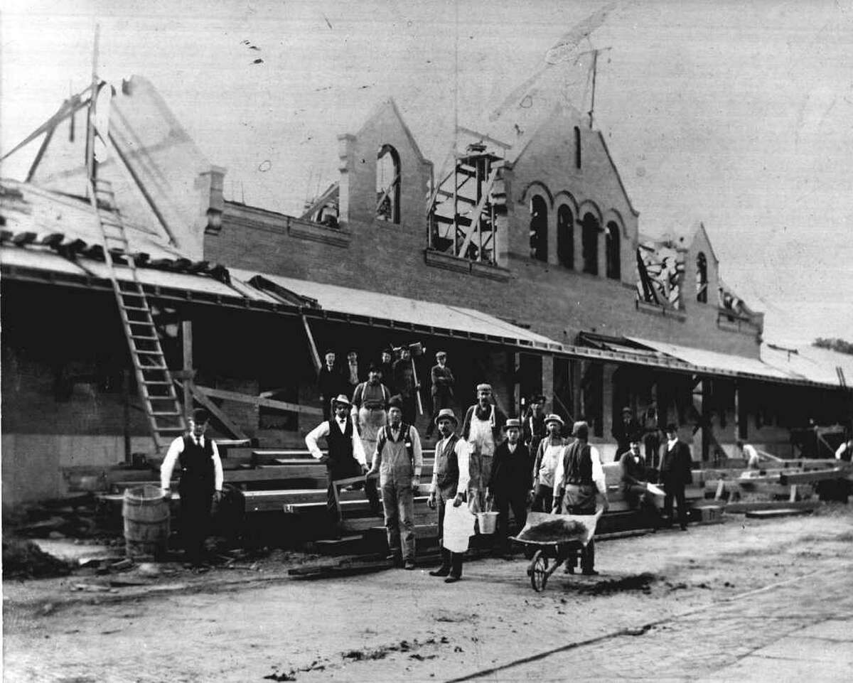 WORKERS REBUILD THE SARATOGA SPRINGS TRAIN STATION IN 1900, AFTER FIRE DESTROYED THE STRUCTURE.--PHOTO COURTESY OF THE GEORGE S. BOLSTER COLLECTION OF THE HISTORICAL SOCIETY OF SARATOGA SPRINGS.