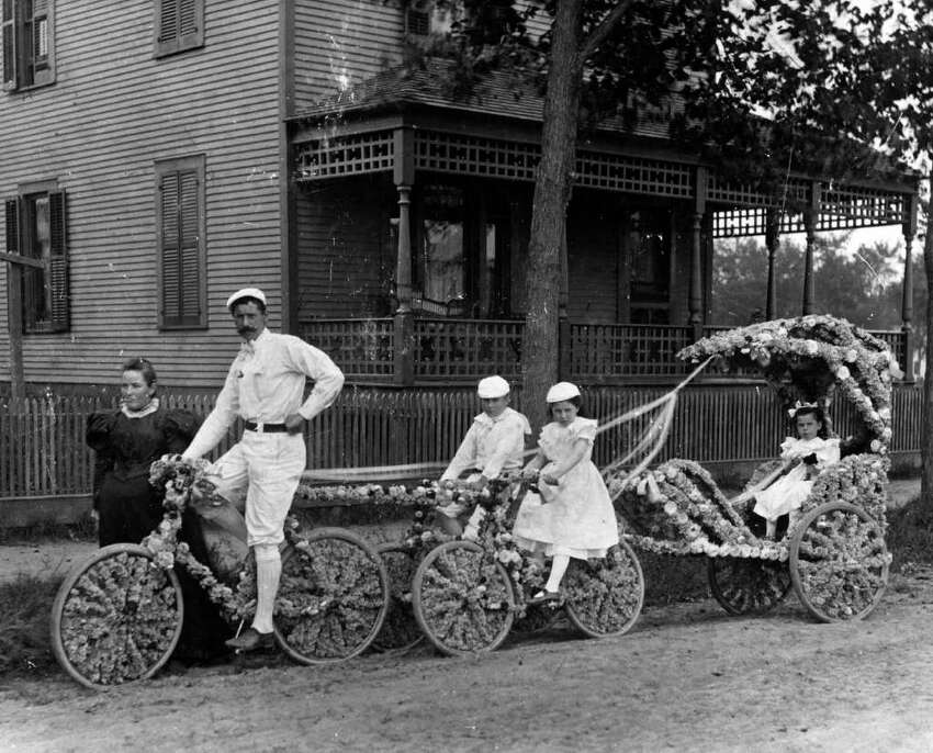 Photo Courtesy of the George S. Bolster Collection of the Historical Society of Saratoga Springs -- Photograher is Macgovern & Baker, Photographers -- Ed Farrington and his family on Circular St.. He was the owner of the Billiard Parlor and Bike Shop in Saratoga Springs.