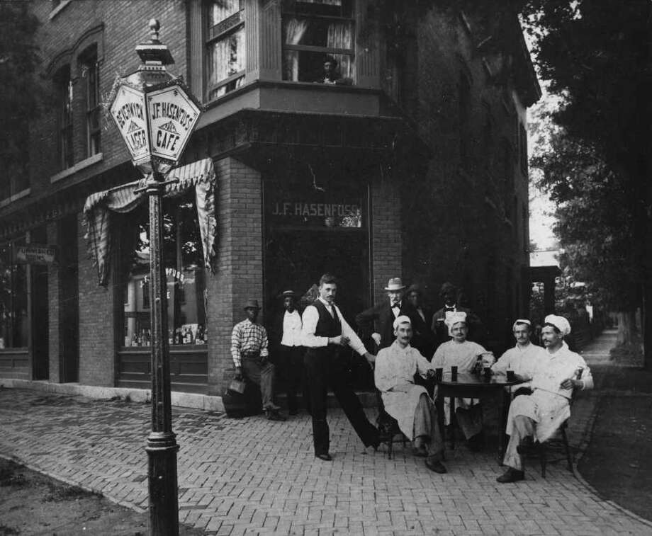 Photo Courtesy of the George S. Bolster Collection of the Historical Society of Saratoga Springs -- Photographer, Unknown -- Chef's from the Grand Union Hotel relax in front of J.F. Hasenfuss Cafe at the corner of Congress and Federal St. in Saratoga Springs in this circa 1900 photo. Photo: UNKNOWN / GEORGE S. BOLSTER COLLECTION