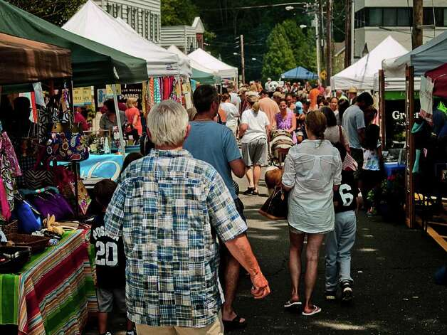 Ridgefield's Summer Fest on July 16 filled Main St. and Bailey Ave. with vendors, performers and locals.  The festivities moved into Ballard Park in the evening with performances by Sgt. Leffert's Phony Hearts Club Band, local cover-band Fog and The Wiyos. Photo: Mike Macklem / Hearst Connecticut Media Group