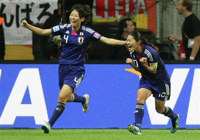 Japan's Homare Sawa, right, celebrates with Japan's Saki Kumagai scoring her side's second goal during the final match between Japan and the United States at the Women�s Soccer World Cup in Frankfurt, Germany, Sunday, July 17, 2011. (AP Photo/Michael Probst)