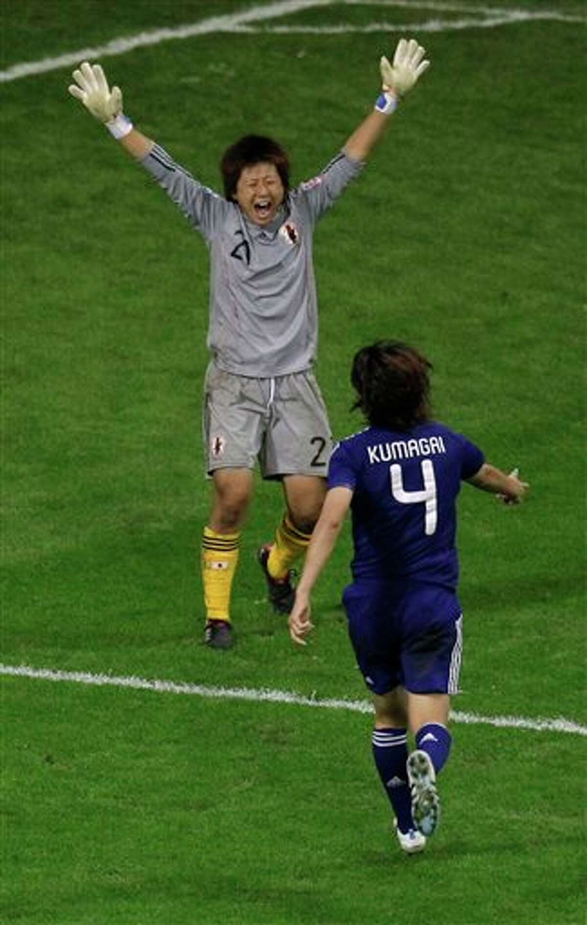 Japan goalkeeper Ayumi Kaihori, left, and Saki Kumagai celebrate winning the final match between Japan and the United States at the Women�s Soccer World Cup in Frankfurt, Germany, Sunday, July 17, 2011. (AP Photo/Michael Sohn)