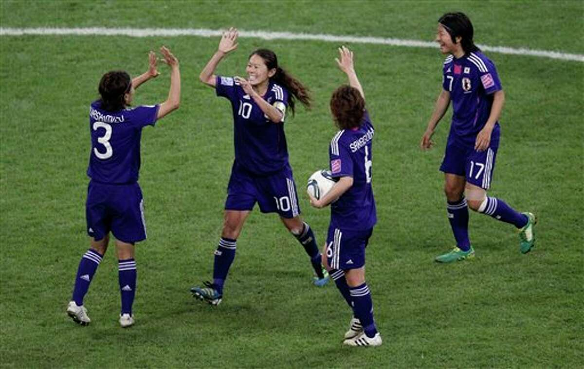 Japan's Homare Sawa, second left, celebrates with teammates scoring her side's second goal during the final match between Japan and the United States at the Women�s Soccer World Cup in Frankfurt, Germany, Sunday, July 17, 2011. (AP Photo/Michael Sohn)