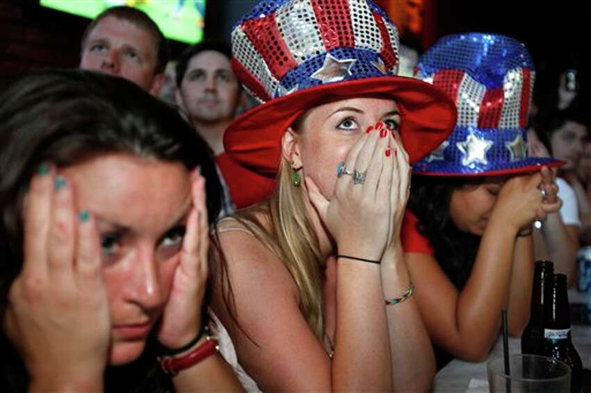 Jessica Doyle, center, and other fans react Sunday, July 17, 2011, in Washington as the U.S. loses to Japan during the Women's World Cup soccer final in Germany. (AP Photo/Jacquelyn Martin)