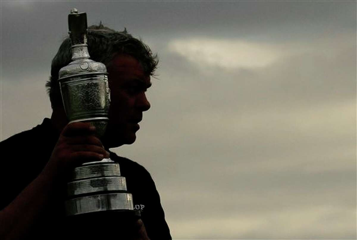 Northern Ireland's Darren Clarke holds the Claret Jug trophy as he celebrates winning the British Open Golf Championship at Royal St George's golf course Sandwich, England, Sunday, July 17, 2011. (AP Photo/Peter Morrison)