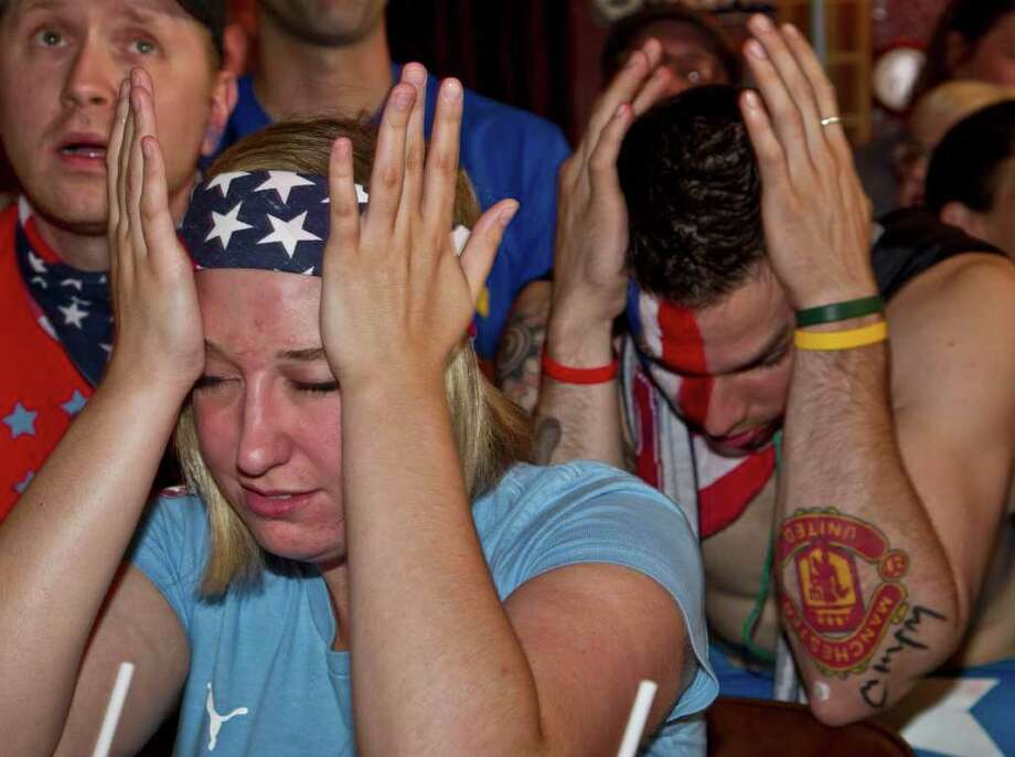 Robyn Vinje and Nicholas Iwaniuk, right, react in the final seconds of the Womenís World Cup soccer final between Japan and the United States, as fans watch the broadcast at the Highbury Pub on Sunday, July 17, 2011, in Milwaukee. Japan defeated the United States in the penalty shootout. (AP Photo/Morry Gash) Photo: Morry Gash, STF / AP