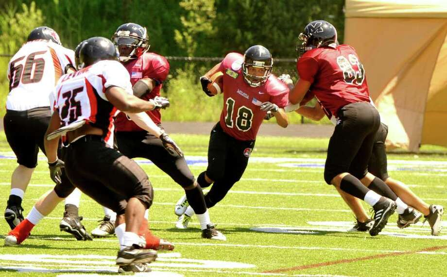 Will Andrew, #18, carries the ball for the Western Connecticut Militia vs. New England Rage at Immaculate High School Sunday, July 17, 2011. Photo: Michael Duffy