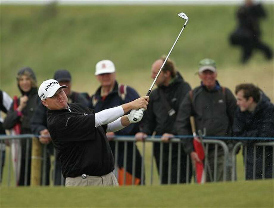 Chad Campbell of the US hits out of the bunker on the 2nd hole during the final day of the British Open Golf Championship at Royal St George's golf course Sandwich, England, Sunday, July 17, 2011. (AP Photo/Tim Hales) Photo: Associated Press