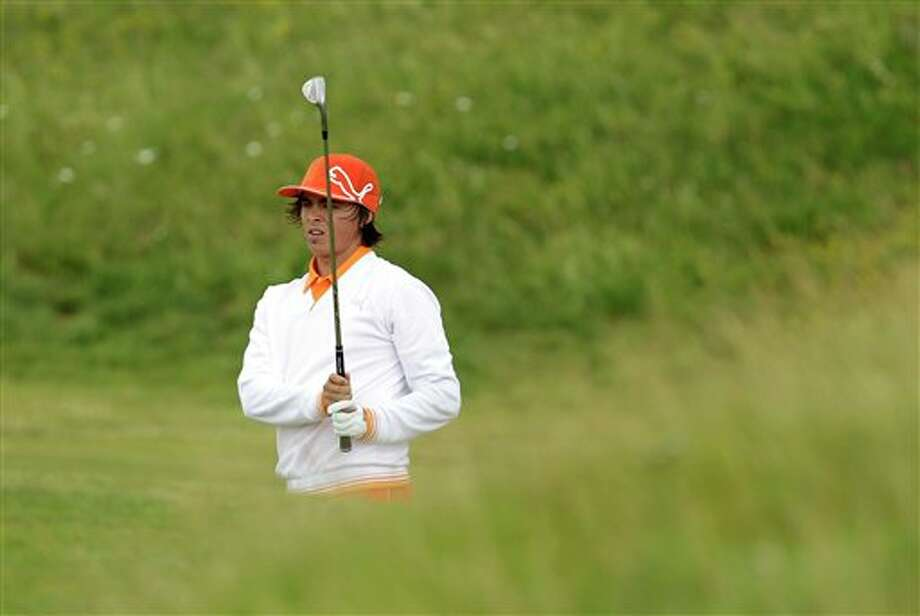 Rickie Fowler of the U.S. watches his shot on the 8th fairway during the final day of the British Open Golf Championship at Royal St George's golf course Sandwich, England, Sunday, July 17, 2011. (AP Photo/Matt Dunham) Photo: Associated Press