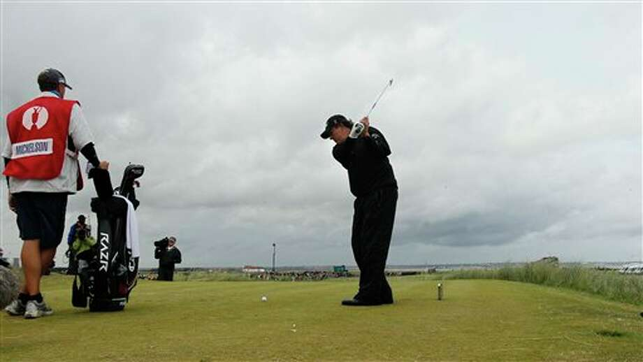 Phil Mickelson of the US hits a shot off the 11th tee during the final day of the British Open Golf Championship at Royal St George's golf course Sandwich, England, Sunday, July 17, 2011. (AP Photo/Jon Super) Photo: Associated Press