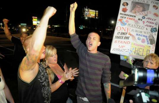 Protestors show their displeasure after Casey Anthony was released from the Orange County Jail in Orlando, Fla., early Sunday, July 17, 2011.(AP Photo/Phelan M. Ebenhack) Photo: Phelan M. Ebenhack, FRE / FR121174 AP