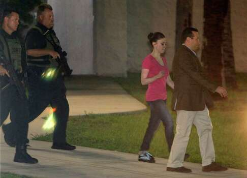 Casey Anthony, second from right, leaves the Orange County Jail with her lawyer Jose Baez, right, as she is escorted by Orange County Sheriff deputies after her release in Orlando, Fla., early Sunday, July 17, 2011.  Anthony was acquitted last week of murder in the death of her daughter, Caylee. (AP Photo/John Raoux) Photo: John Raoux, STF / AP