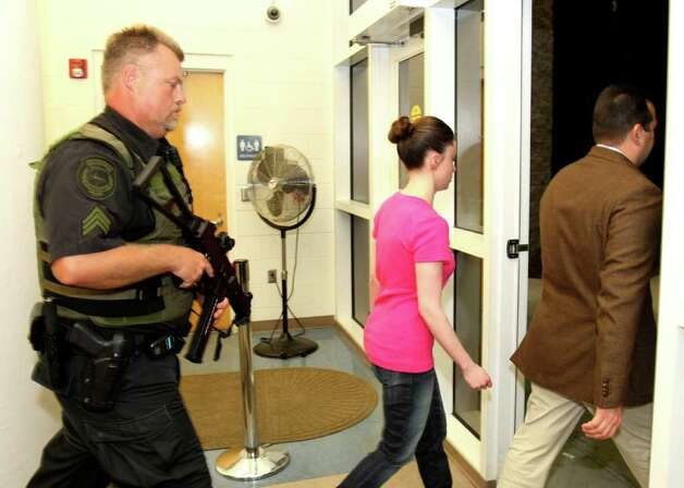 Casey Anthony, center, walks out of the Orange County Jail with her attorney Jose Baez, right, during her release in Orlando, Fla., early Sunday, July 17, 2011.  Anthony was acquitted last week of murder in the death of her daughter, Caylee. (AP Photo/Red Huber, Pool) Photo: Red Huber, POOL / Pool Orlando Sentinel