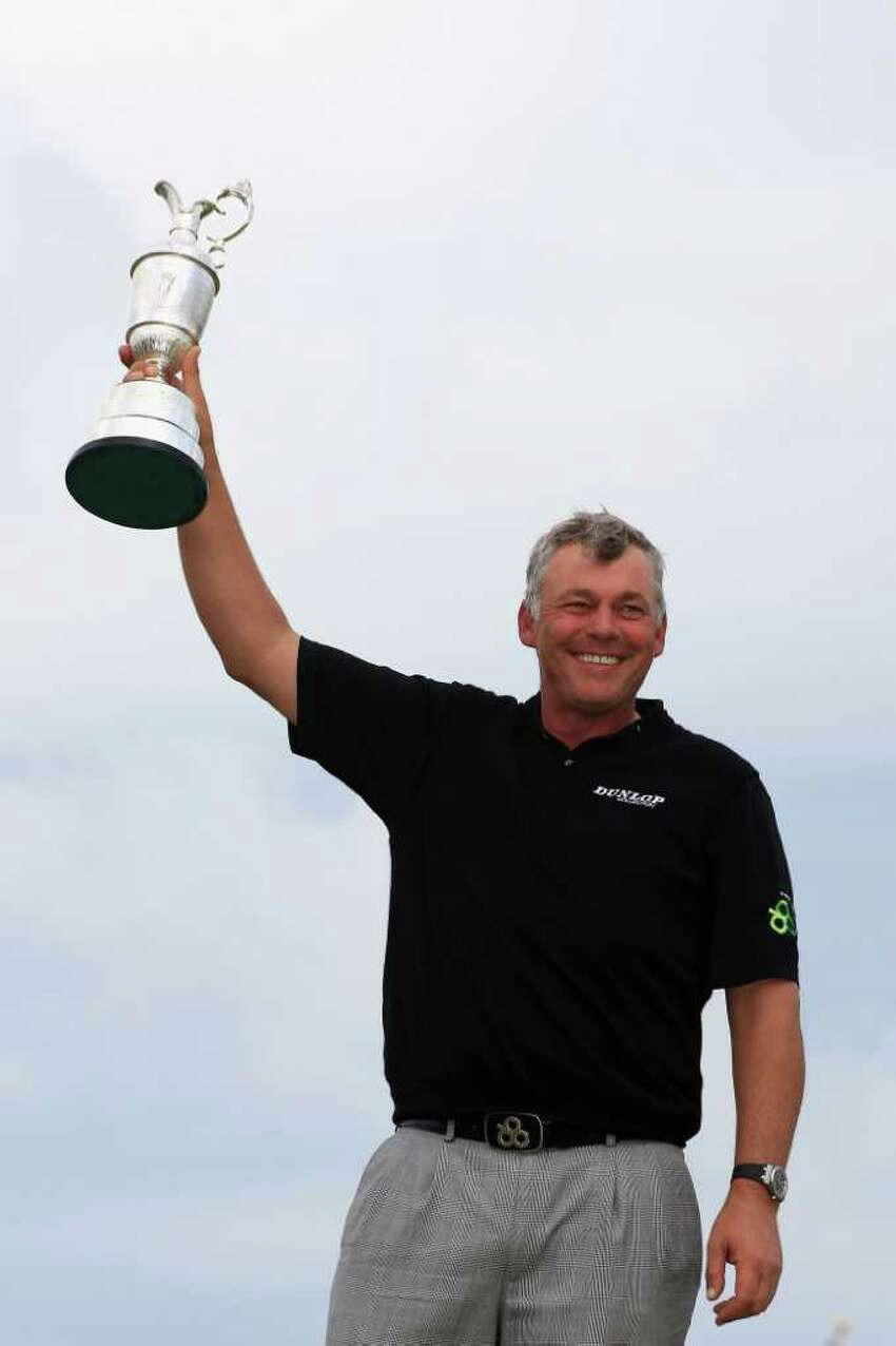 SANDWICH, ENGLAND - JULY 17: Darren Clarke of Northern Ireland holds the Claret Jug aloft following his victory at the end of the final round of The 140th Open Championship at Royal St George's on July 17, 2011 in Sandwich, England. (Photo by Streeter Lecka/Getty Images)