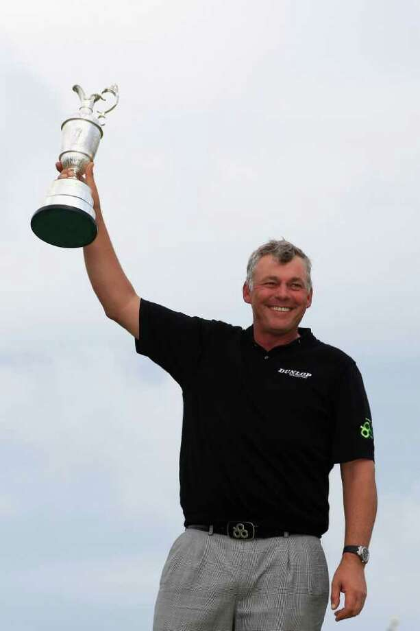 SANDWICH, ENGLAND - JULY 17:  Darren Clarke of Northern Ireland holds the Claret Jug aloft following his victory at the end of the final round of The 140th Open Championship at Royal St George's on July 17, 2011 in Sandwich, England.  (Photo by Streeter Lecka/Getty Images) Photo: Streeter Lecka, Getty Images / 2011 Getty Images