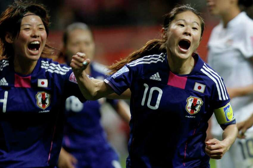FRANKFURT AM MAIN, GERMANY - JULY 17: Homare Sawa of Japan celebrates scoring the second goal during the FIFA Women's World Cup Final match between Japan and USA at the FIFA World Cup stadium Frankfurt on July 17, 2011 in Frankfurt am Main, Germany. (Photo by Friedemann Vogel/Getty Images)