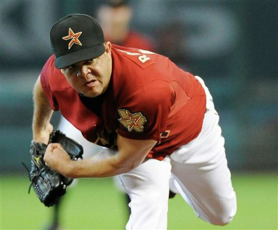 Houston Astros' Wandy Rodriguez follows through on a pitch in the second inning against the Pittsburgh Pirates in a baseball game Sunday, July 17, 2011, in Houston. (AP Photo/Pat Sullivan) Photo: Associated Press