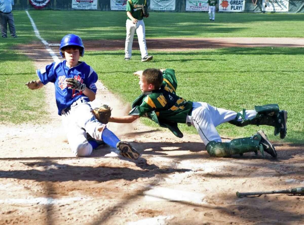 National Lione's Chipper Howe tags North Stamford's Alex Mella out at home as the teams face off in the Little League District 1 Championship at Scalzi Park in Stamford, Conn., July 17, 2011. North Stamford won the game 9-5.