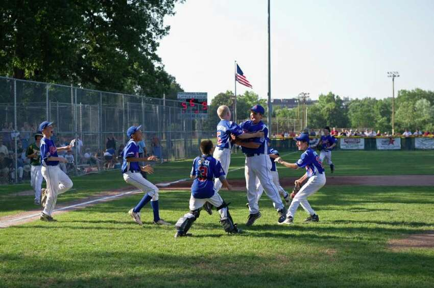 North Stamford celebrates after defeating National Lione 9-5 in the Little League District 1 Championship at Scalzi Park in Stamford, Conn., July 17, 2011.