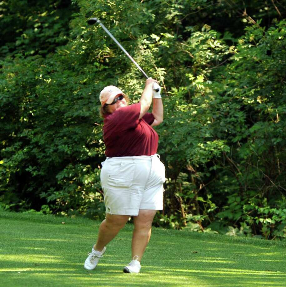 Laurie White plays in the 21st Annual Danbury Amateur golf tournament at Richter Park Golf Course in Danbury, Sunday, July 17, 2011. Photo: Michael Duffy