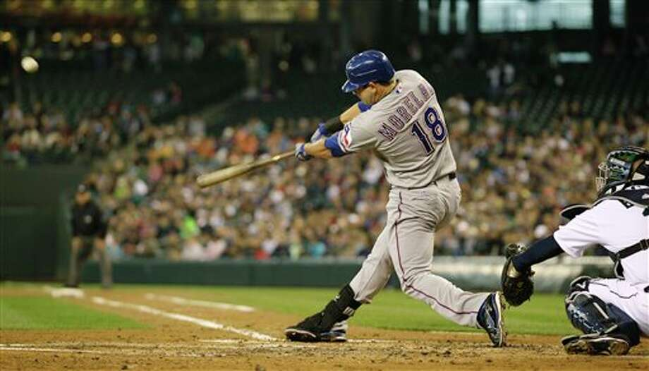 Texas Rangers' Mitch Moreland hits a three-run home run against the Seattle Mariners in the second inning of a baseball game, Sunday, July 17, 2011, in Seattle. (AP Photo/Ted S. Warren) Photo: Associated Press