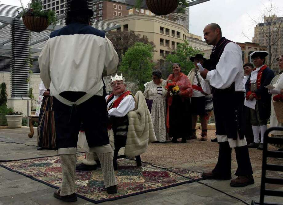 Dr. Alfonso Chiscano (seated) plays King Felipe V of Spain during a 2009 play in Main Plaza near San Fernando Cathedral. The play depicted the arrival of the original 16 families from the Canary Islands in 1731 to what is now San Antonio. Photo: Express-News File Photo / jdavenport@express-news.net