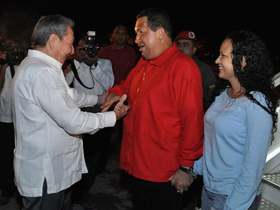 In this photo released on Sunday July 17, 2011 by the state media Cubadebate website, Cuba's President Raul Castro, left, greets Venezuela's President Hugo Chavez, accompanied by his daughter Rosa Virginia, upon their arrival at the Jose Marti International Airport in Havana, Cuba, Saturday July 16, 2011. Chavez has returned to Cuba to begin chemotherapy nearly a month after surgery to remove a tumor, and he is expressing optimism the treatment will help him survive his cancer. Chavez said he would start the treatment in Havana on Sunday. (AP Photo/Cubadebate, Estudios Revolucion)
