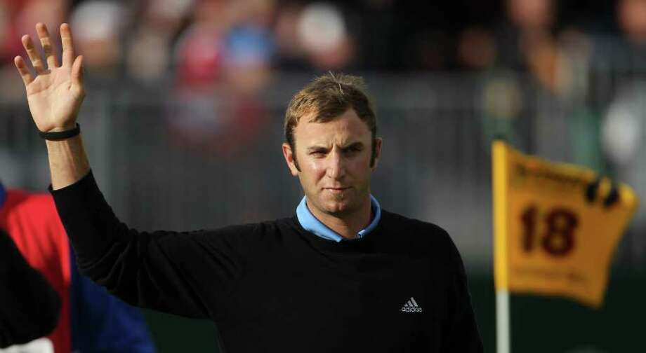 Dustin Johnson of the US reacts on the 18th green after finishing his round during the third day of the British Open Golf Championship at Royal St George's golf course Sandwich, England, Saturday, July 16, 2011. (AP Photo/Tim Hales) Photo: Tim Hales, STR / AP