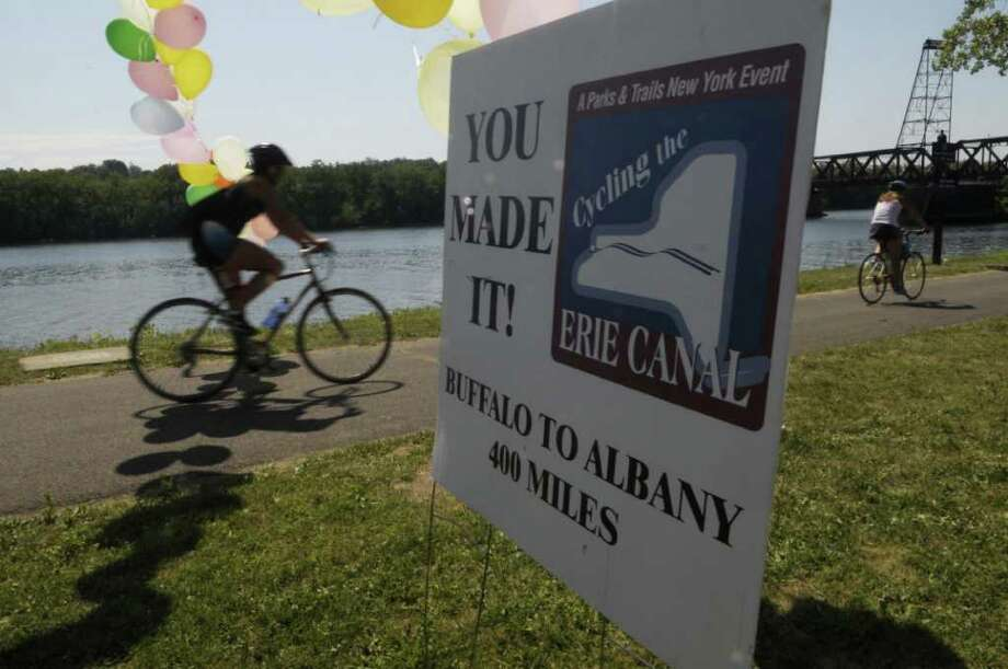 A sign welcomes cyclists at the finish line at the Corning Preserve where riders taking part in the 13th annual Cycling the Erie Canal tour ended their eight day ride on Sunday, July 17, 2011 in Albany.  Some 500 bicyclists from 35 states took part in the tour this year.   The 400-mile bicycle tour began last Sunday in Buffalo.    (Paul Buckowski / Times Union) Photo: Paul Buckowski  / 00013940A