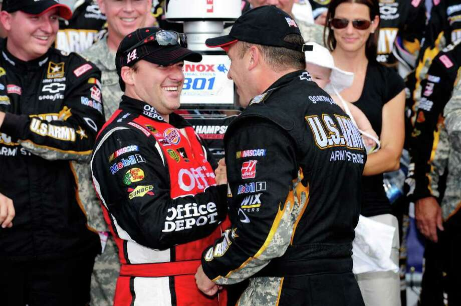 LOUDON, NH - JULY 17:  Ryan Newman (R), driver of the #39 U.S. Army Chevrolet, is congratulated by team owner and second place finisher, Tony Stewart (L), driver of the #14 Office Depot/Mobil 1 Chevrolet, in Victory Lane after winning the NASCAR Sprint Cup Series LENOX Industrial Tools 301 at New Hampshire Motor Speedway on July 17, 2011 in Loudon, New Hampshire.  (Photo by Jared C. Tilton/Getty Images) Photo: Jared C. Tilton, Stringer / 2011 Getty Images