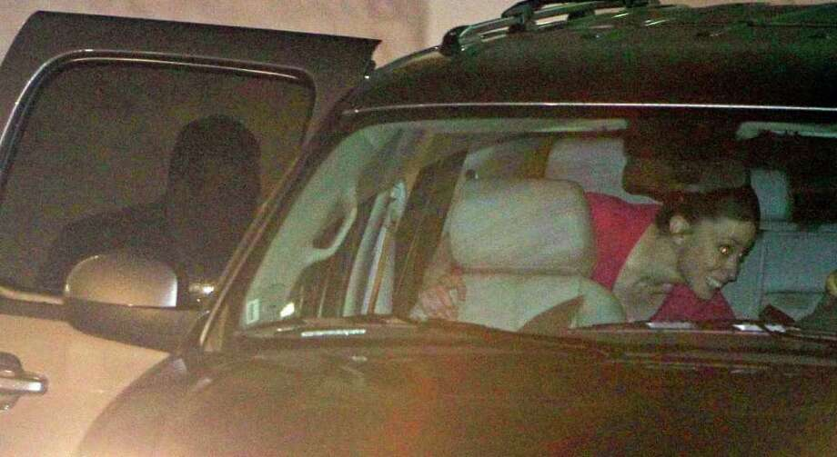 Casey Anthony, right, climbs into an SUV with her lawyer Jose Baez, left, after her release from the Orange County Jail in Orlando, Fla., early Sunday, July 17, 2011.  Anthony was acquitted last week of murder in the death of her daughter, Caylee. Photo: AP