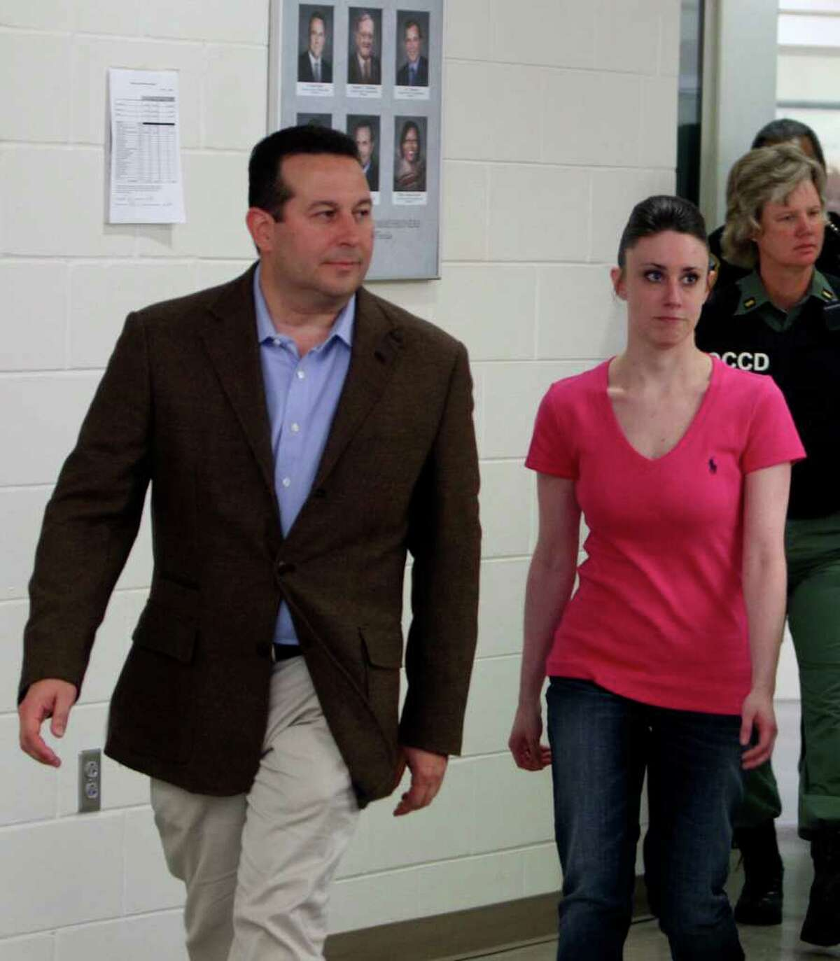 Casey Anthony, front right, walks out of the Orange County Jail with her attorney Jose Baez, left, during her release in Orlando, Fla., early Sunday, July 17, 2011. Anthony was acquitted last week of murder in the death of her daughter, Caylee.