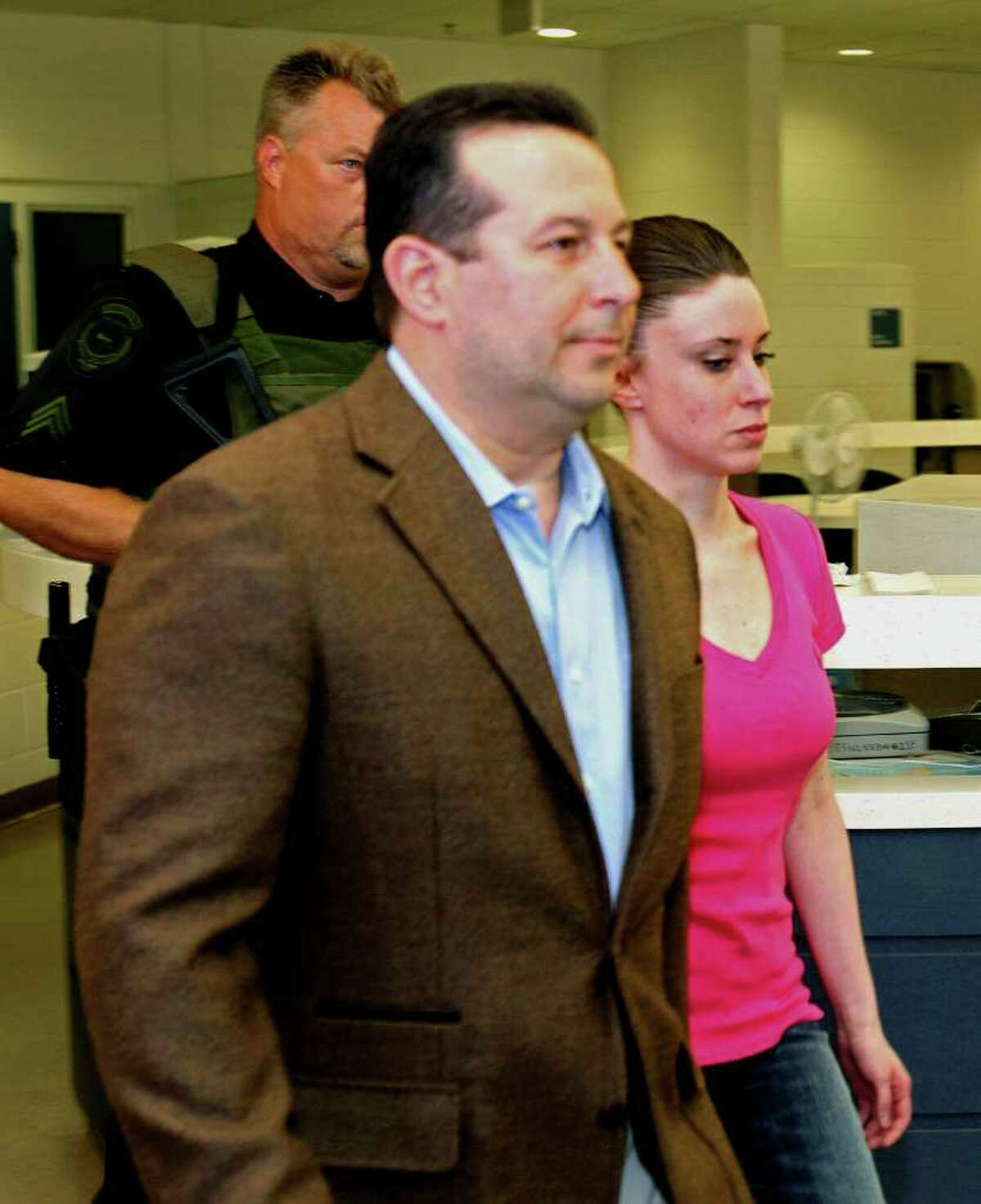 Casey Anthony, front right, walks out of the Orange County Jail with her attorney Jose Baez, left, during her release in Orlando, Fla., Sunday, July 17, 2011. Anthony was acquitted last week of murder in the death of her daughter, Caylee.