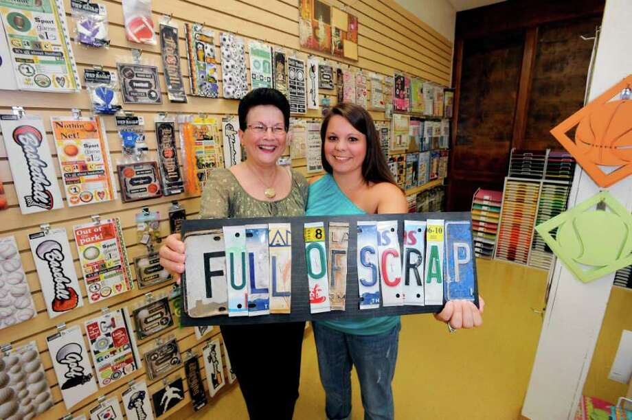 """Marilyn Parks, left, and Wende Zambardino are co-owners of their scrapbook store, """"Full of Scrap."""" Valentino Mauricio/The Enterprise"""