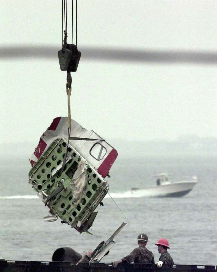 In this Aug. 3, 1996, file photo, a door from the wreckage of TWA Flight 800 is unloaded at the Shinnecock Coast Guard Station in Hampton Bays, N.Y. On Sunday, July 17, 2011, people will gather on a Long Island beach to mark the 15th anniversary of the jetliner's explosion and crash. (AP Photo/Bebeto Matthews, File) Photo: BEBETO MATTHEWS, Associated Press / AP