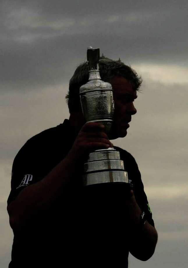 Northern Ireland's Darren Clarke holds the Claret Jug trophy as he celebrates winning the British Open Golf Championship at Royal St George's golf course Sandwich, England, Sunday, July 17, 2011. (AP Photo/Peter Morrison) Photo: Peter Morrison, STR / AP