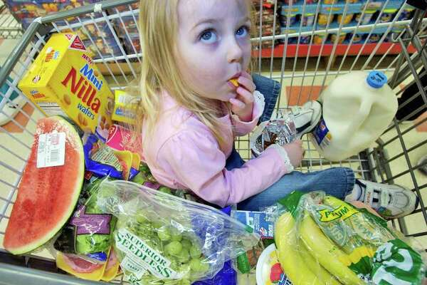 Keira O'Keefe, 2, eats a snack in a grocery cart, Friday, June 15, 2007 at a grocery store in Danvers, Mass. Consumer prices shot up at the fastest pace in 20 months in May, fueled by a surge in gas prices, although inflation pressures were moderate in most other areas.