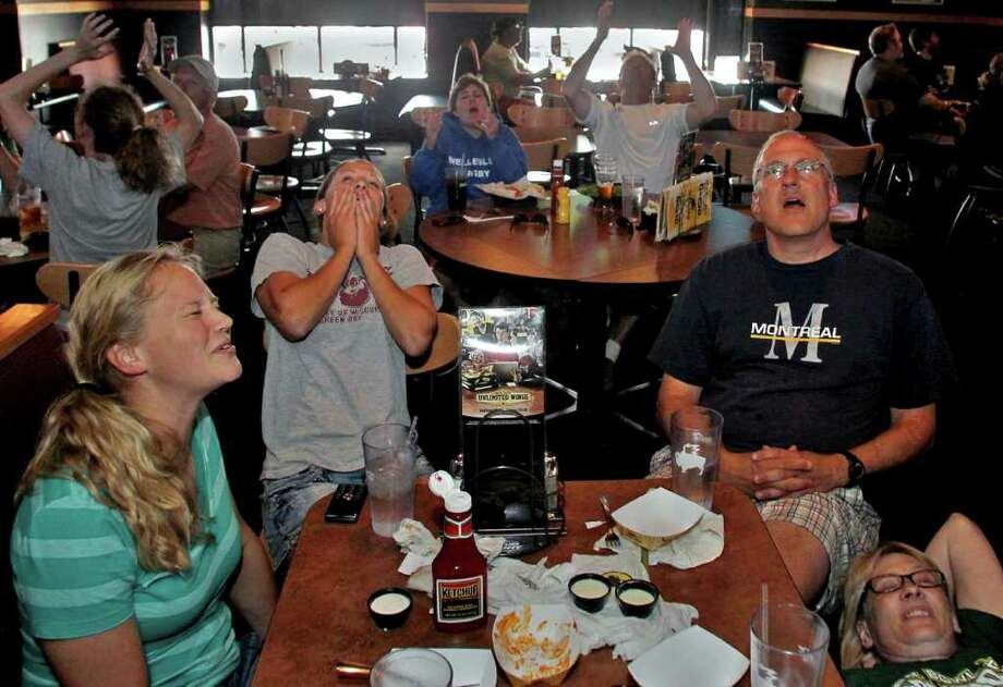 The Henry family, clockwise from left, Claire, Ann, Joe and Martha Henry react as they watch a broadcast of the United States lose to Japan on penalty kicks in the Women's World Cup final soccer match, Sunday, July 17, 2011, in Wausau, Wis. (AP Photo/The Wausau Daily Herald, Dan Young) Photo: Dan Young, MBR / Wausau Daily Herald