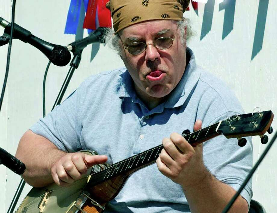 SPECTRUM/Crowd-pleasing Guy Wolf of Bantam, the old-time banjo champion in 2010, has a grand time playing for the crowd but settles for third place at the Pickin'n Fiddlin' contest in Roxbury, July 22, 2011 Photo: Trish Haldin