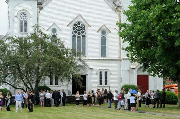 Mourners share their grief as they leave the Cambridge United Presbyterian Church in Cambridge, N.Y. July 18, 2011, after the funeral of Dan Harrington, Deputy Town Highway Superintendent for the Town of White Creek, his wife Lisa Harrington and step son Josh O'Brien who were shot to death and their bodies burned allegedly by their son Mathew Slocum.  (Skip Dickstein / Times Union) Photo: SKIP DICKSTEIN / 2011