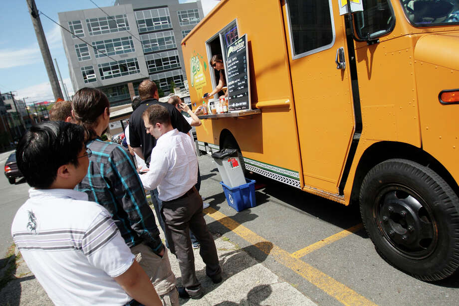 Customers in line for Pai's food truck on Harrison St. and Fairview Ave. on Monday July 17, 2011 Photo: JOE DYER / SEATTLEPI.COM