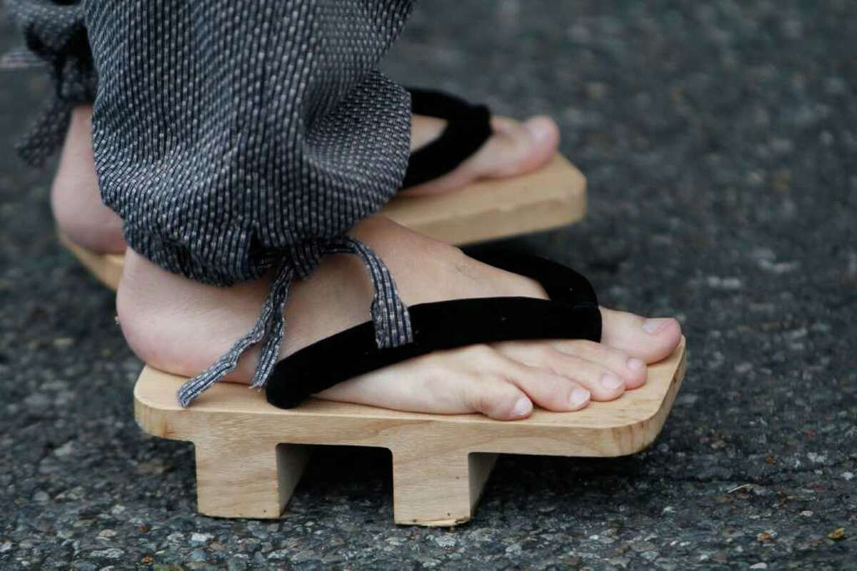 A man wears traditional Japanese sandals during the Bon Odori Festival. The festival, an official Seafair event, features traditional Japanese music and dancing in the street -- as well as martial arts performances, Japanese food booths and craft exhibits.