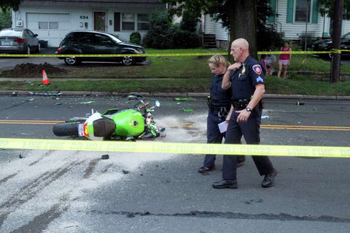 Stamford police officers Jessica Bloomberg, left, and Sgt. Carl Strate, right, at the scene of a fatal car versus motorcycle accident on Hope St. on Monday, July 18, 2011. According to Lt. Sean Cooney, the motorcyclist, Fernando Quintero-Montano, sustained serious injuries and was transported to Stamford Hospital. The driver of the SUV which was traveling southbound on Hope was not injured. Police have closed Hope at Viaduct Road.