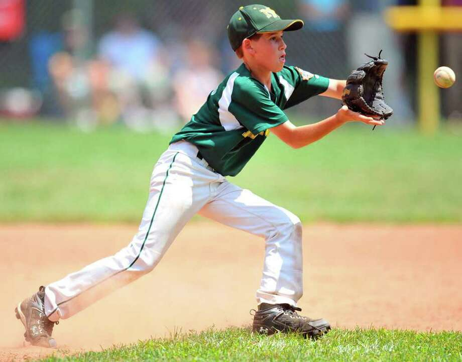 SPECTRUM/Chris Gesualdi keeps his focus as he makes a defensive play for the New Mlford Thunder during last week's Cal Ripken state baseball tournament at Garick Farms Field. Photo: Contributed Photo
