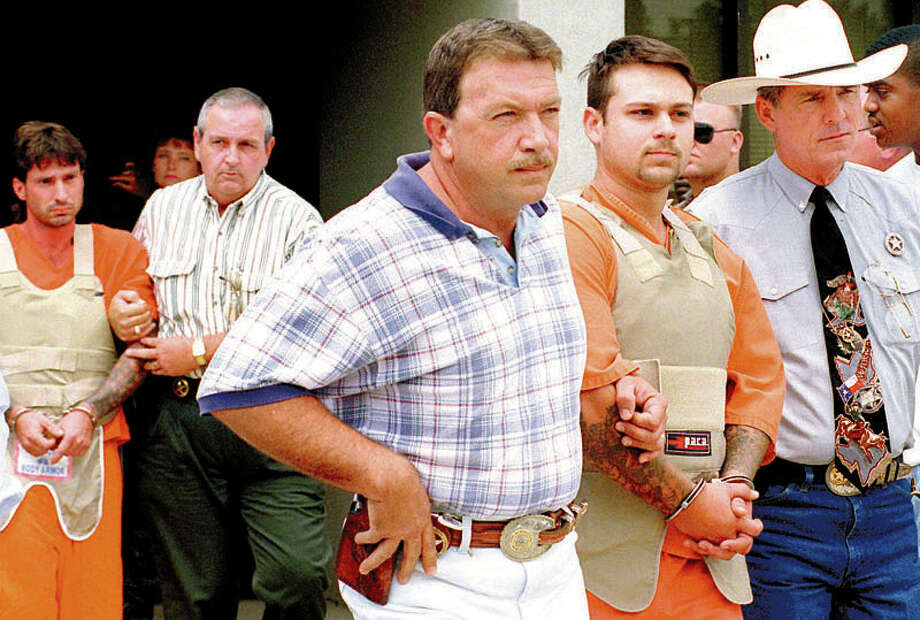 Lawrence Russell Brewer, back left, and John William King, right, are taken from the Aubrey Cole Law Enforcement Center in Jasper to appear before the district attorney at the Jasper County Courthouse  on  June 9, 1998. Brewer and King are on death row at the Polunsky Unit in Livingston for the killing of James Byrd Jr  A third defendant, Shawn Berry, is serving a life sentence at the Ramsey Unit in Rosharon. Enterprise file photo Photo: File