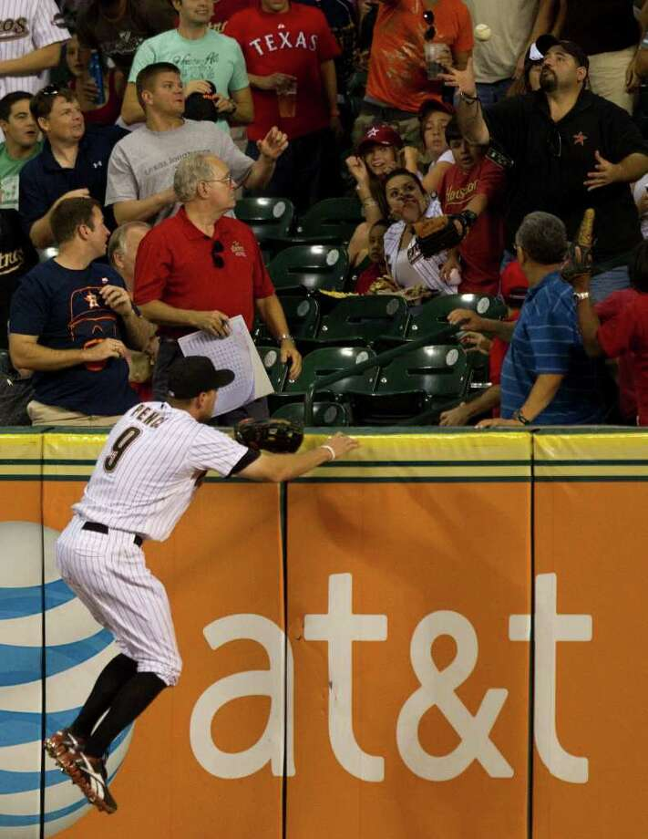Houston Astros right fielder Hunter Pence (9) leaps in vain for a ball hit out of the park by Washington Nationals third baseman Ryan Zimmerman during the seventh inning of a major league baseball game at Minute Maid Park Monday, July 18, 2011, in Houston. ( Brett Coomer / Houston Chronicle ) Photo: Brett Coomer, Staff / © 2011 Houston Chronicle