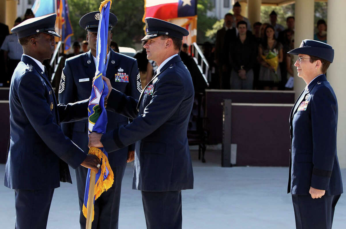 Air Force Brigadier Leonard A. Patrick (center) relinquishes command of the 502d Air Base Wing Joint Base San Antonio on July 18, 2011, during a change of command ceremony at the MacArthur Parade Field at Fort Sam Houston. On the left is the event's presiding officer General Edward A. Rice, Jr., and standing on the right is Brigadier General Theresa C. Carter who is sassuming command of Joint Base San Antonio. Standing between Rice and Carter (facing) is Command Chief Juan Lewis.