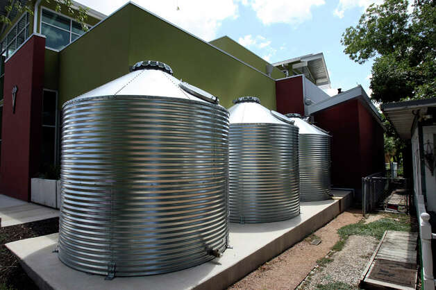 The rainwater collection system at Eagle Veterinary Hospital can collect up to 9,300 gallons of water. Photo: HELEN L. MONTOYA / hmontoya@express-news.net