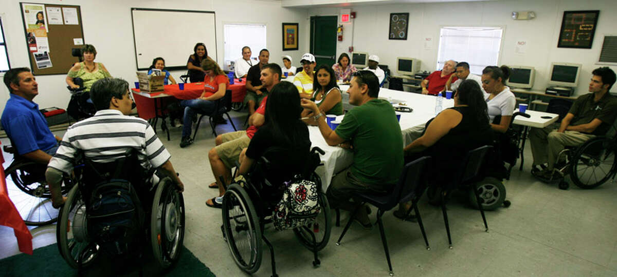 Rolling Inspiration group members attend their weekly meeting along with family members and caretakers on July 13, 2011.