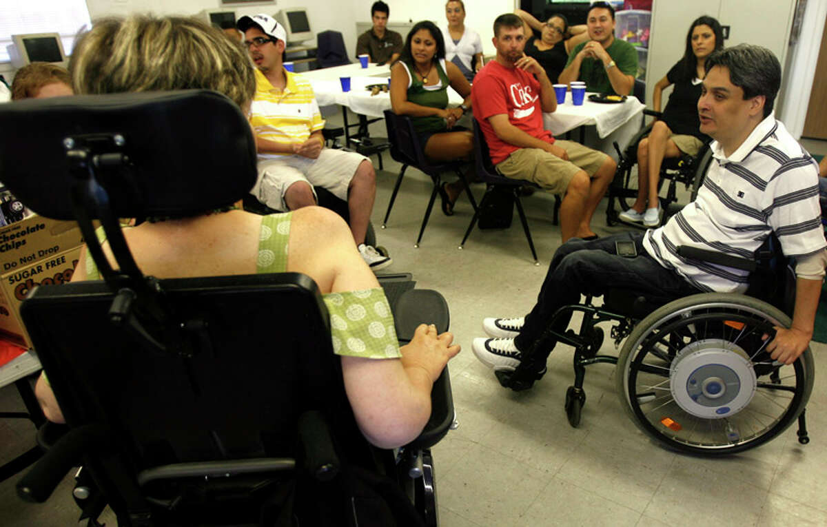 Rolling Inspiration, a support group for spinal cord injury-ridden people founded by Chris Salas (right), meets on July 13, 2011.